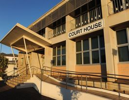 Three in court over assault