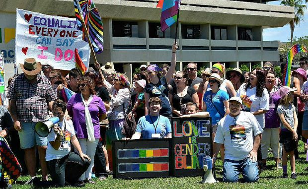Marriage equality supporters rally prior to a march through Mackay streets at the weekend. More than 180 people took part.