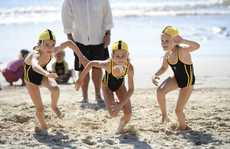 Kalani Ives, 7 (centre) gets a flying start on her opponents in the beach flags event at Yamba Nippers Photo Adam Hourigan / The Daily Examiner