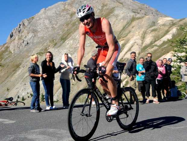 Australian David Dellow rides his bike on the road leading to the Izoard pass during the 29th edition of the Embrun Man triathlon on August 15, 2012 near Briancon, southeastern France. The Embrun Man is considered as one of the hardest triathlon events with a swim of 3.8km followed by a 188km cycle ride and a 42km marathon.