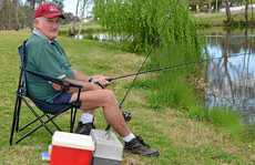 CONTENTED FISHERMAN: Kev Farley, of Allora, on the banks of the Condamine River in Warwick.