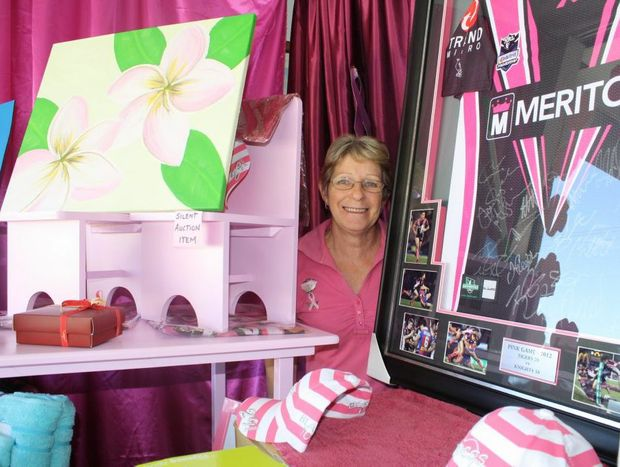 Breast cancer luncheon organiser Margaret Grayson with some of the great items up for grabs in the silent auction.