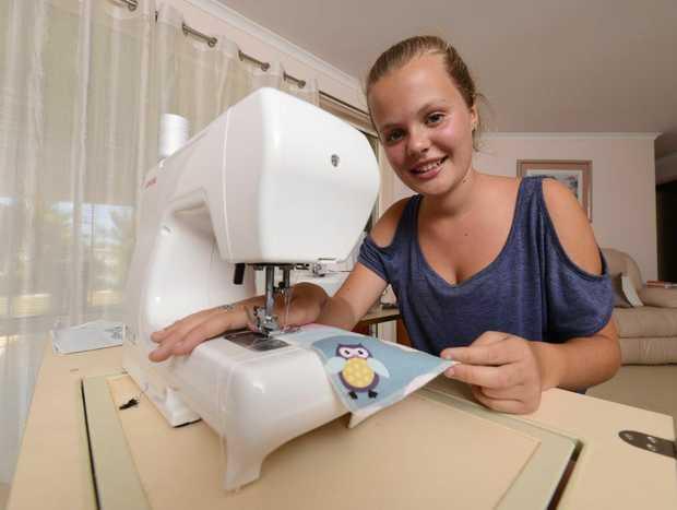 Caitlin Creber, 13,  preparing items for the Homemade Markets in Yamba. Photo: Adam Hourigan / The Daily Examiner