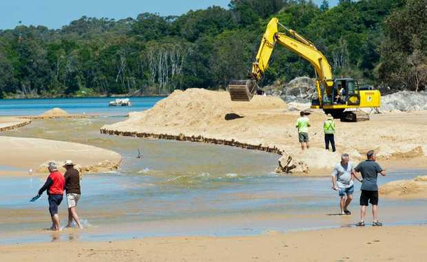 Work begins to clear the outlet of Pine Creek near Sawtell South Headland. Photo: Rob Wright