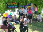 Demonstrators meet under rainbow banners at Queens Park for the Love Is Worth Fighting For rally.