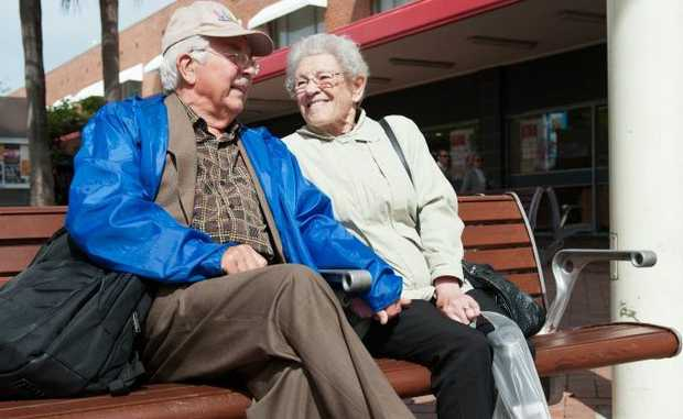 Even Mossvale couple Bob and Sue Smith found it cold in Coffs, huddling together for some extra heat. Photo: Rob Wright/The Coffs Coast Advocate.