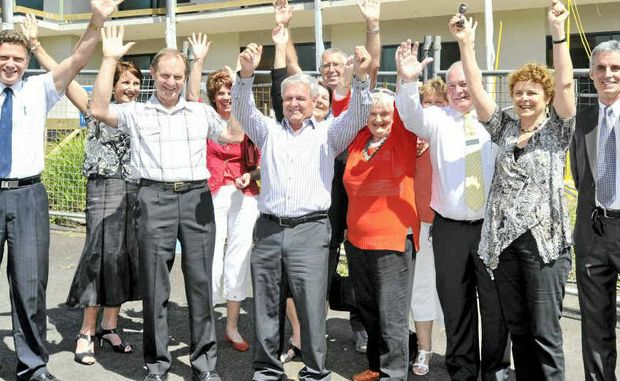 WELL DONE: Members of the Ballina Shire Our House fundraising committee, with Dr Chris Ingall, Our House committee chairman (far left), in front of the nearly finished Our House building.