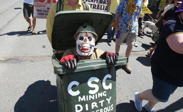 A marcher making a trashy statement against coal-seam gas.
