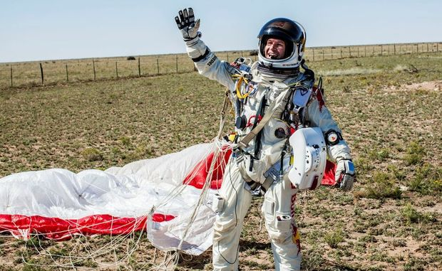 In this photo Pilot Felix Baumgartner of Austria celebrates after successfully completing the final manned flight for Red Bull Stratos in Roswell, N.M. on Sunday Oct 14, 2012. Baumgartner came down safely in the New Mexico desert minutes about nine minutes after jumping from his capsule 128,097 feet above Earth.