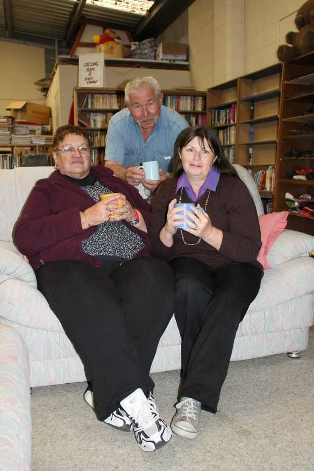 KAY'S CORNER: Stanthorpe Community Op Shop manager Lorraine Aldis, co-founder Frank Moser and assistant manager Debbie Lightfoot-de Hamer cosy up in their new Have a Chat Community Lounge. Photo Linden Morris / Stanthorpe Border Post