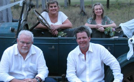 "Kim West (Edman), Samantha Cayzer, Peter West and Ian ""Marsie"" Maher pose in front of Marsie's 1920's Chevrolet."