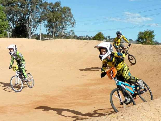 Aaron and Noah Sharrock racing with their father Andrew at the South Grafton BMX track on Saturday. Photo: Contributed