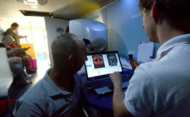 Andrew Berry with skin consultant Nathan Cox in the Sunsence UV Photobus. Photo: Leigh Jensen/The Coffs Coast Advocate.