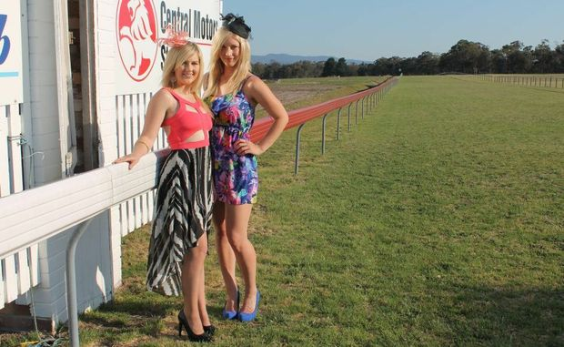 PHOTO FINISH: Kyrie Sweeny and Ashleigh Taylor take a test run of their races Fashion of the Fields outdits in the lead up to the Central Motors Holden Stanthorpe Cup Day on Saturday. Story page 5. Photo Linden Morris / Stanthorpe Border Post