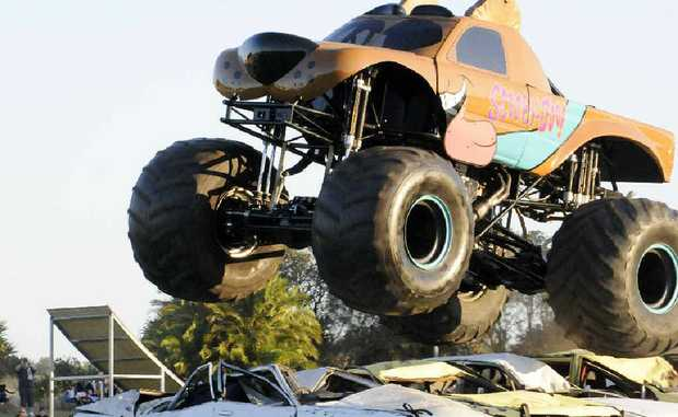 BIG JUMP: Monster truck Scooby Doo makes a jump over five cars at Ballina's Kingsford Smith Park last Saturday night.