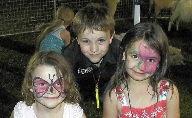 Felicity Nolan, John Nolan and Reagan McMillan have fun at Viv's Farmyard Shearing Shed last year.