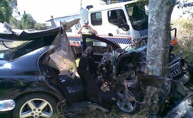 TWO people were trapped after this car left Duncans Rd at Numulgi and crashed into a tree about noon, Saturday, October 20.