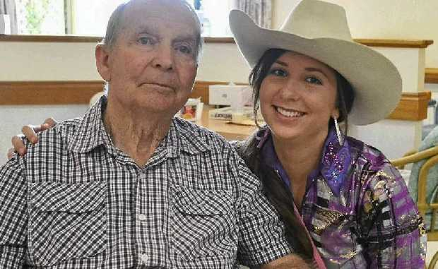 Miss Appearance Laura Lee with her grandfather Ronnie, during the Warwick Rodeo queens and princess tour of Akooramak on Monday.