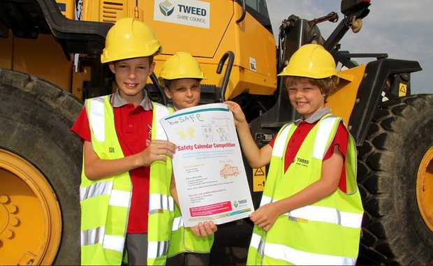 Locke Nash, 10, Kane O'Brien, 9 and Jeremy Nash, 8 are keen to take part in the colouring part of Safety Week. Photo: Contributed