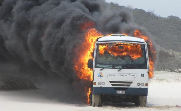 A Fraser Island tour bus is engulfed in flames near the Maheno shipwreck on October 23.