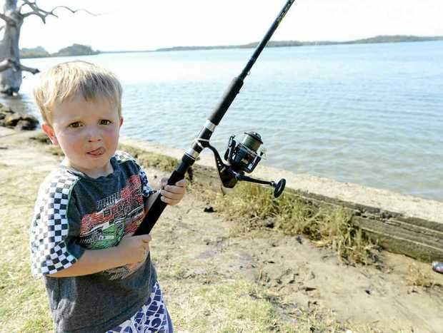 Brock Taylor, 2, joins in the fun while fishing on the Clarence River at Yamba on Saturday. Photo: Debrah Novak