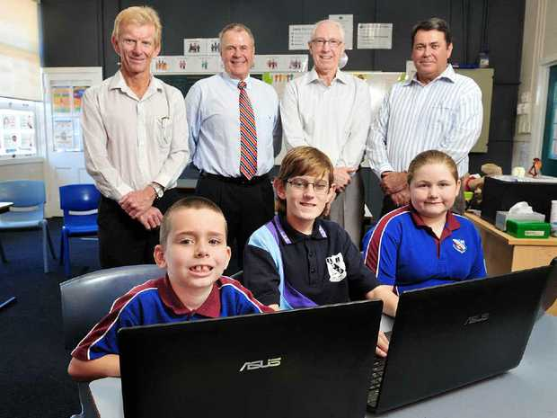 MEETING NEEDS: Donors (from left) Peter Price, Neil Harvey, Bob McNamara and Joe Richardson watch as Leichhardt State School students Zachary Brown, Aiden MacBeth and Angel-Lee Bate use their new computers.