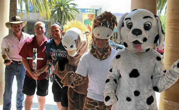 Warwick's celebrities are ready for tonight's horse race and are all chasing after the Buchner Cup. (From left) David Bishop, John Creed, Seth Jameson, Trigger the Horse, Ziggy the Giraffe and Daily Dalmatian.