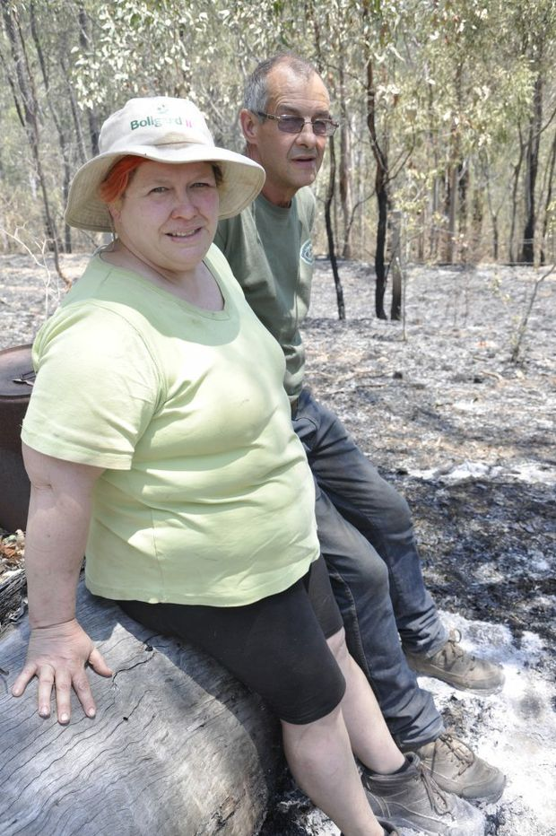 Redbank Creek couple Liz and Paul Matson inspect where the grassfire reached the boundary of their property.