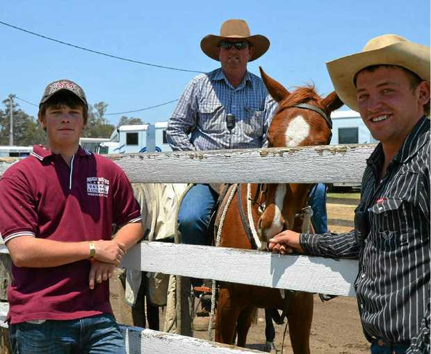 Jake Keogh, Glen Fanning on Bailey and Dan Roche are just a few of the volunteer laneway men working at the Warwick Rodeo and Campdraft this week.