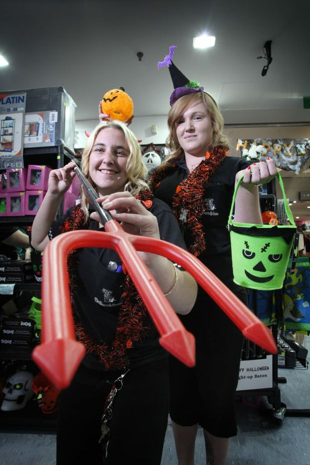 Talia Bannerman and Amber Steele from Dollars and Sense which is overflowing with Halloween stock this year as popularity rises. Photo: Inga Williams / The Reporter