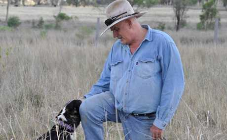Cyril Stewart, president Coopers Gap Wind Farm Supporters Group, and dog Bonnie, on his property near Cooranga North, 650m from a proposed turbine.  Photo Gen Kennedy /
