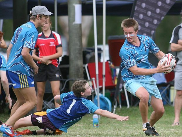 Capricorn Coast Stingrays player Dan Adamson in action at the Red Rooster Junior Touch Football Carnival held in Rockhampton. Photo: Chris Ison / The Morning Bulletin
