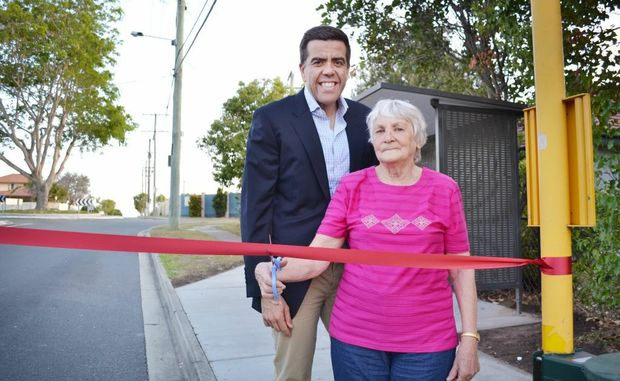 NEW AND IMPROVED: Richlands councillor Milton Dick and Inala resident Margaret Stone unveils one of the newly refurbished bus stops within the community. Photo: Inga Williams / The Satellite