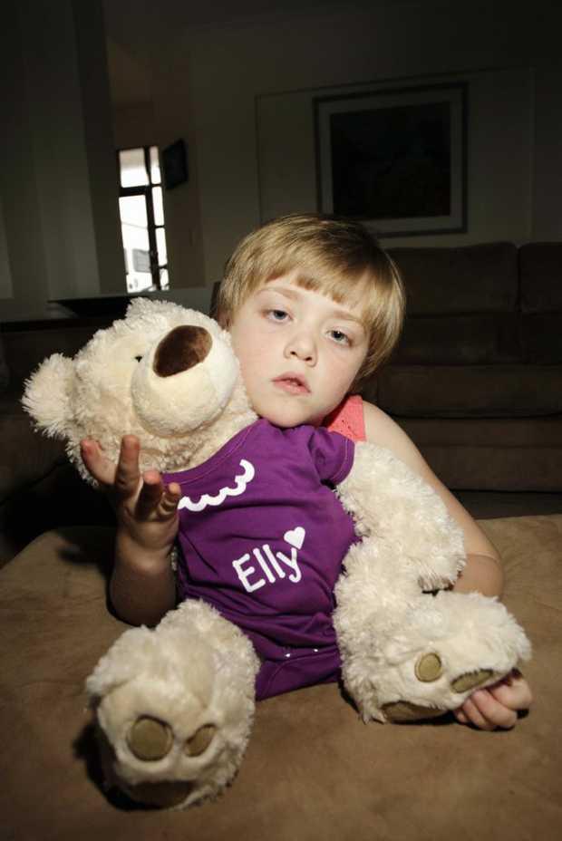 Ella Dennent keeps her travelling Epilespy Bear, Ella close to her. photo Vicki Wood