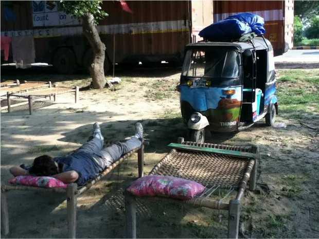 RICKSHAW ROVING: Kira Hartland takes a well-earned break during her trek through Northern India on a motorised rickshaw. Photo contributed.