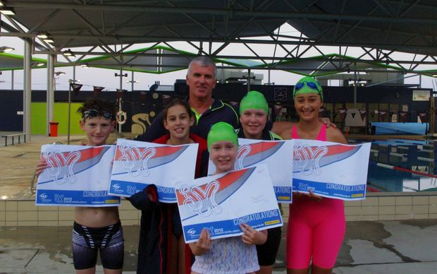 Richmond Valley Swim Club members (from left) Caleb Yourell, Rachel Redman, Tara Blunn, Aimee Landrigan and Chloe Gillet received Australian Junior Excellence Program awards from club coach Michael Freney (back). Photo Contributed