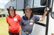 Organisers Jenny Gray and dad Bob Vickers with their touring bus at the Grafton Fair Dinkum Country Music Roundup. Photo: Adam Hourigan / The Daily Examiner