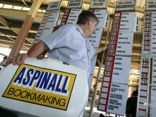 Better day - local bookmaker Vince Aspinal at Callaghan Park when it wasn't drench by rain.