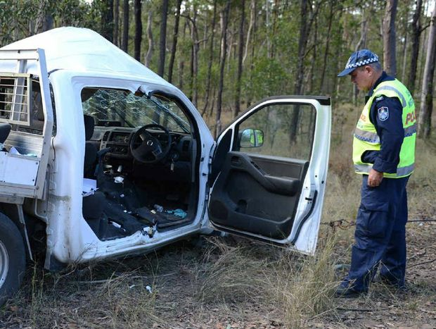 Forensic crash investigator Sergeant Steve Webb inspects the wreck of a Nissan Navara ute which crashed killing 14-year-old Ophelia Silcox.