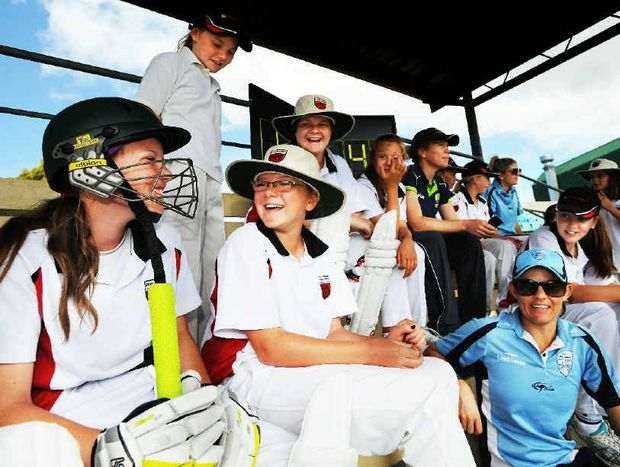ADVICE FROM THE TOP: Erin Osbourne, Alex Blackwell and Kara Sutherland, who represent the NSW Breakers and the Australian Southern Stars, with Sydney North players at Oakes Oval, Lismore, yesterday during the PSSA girls cricket carnival.