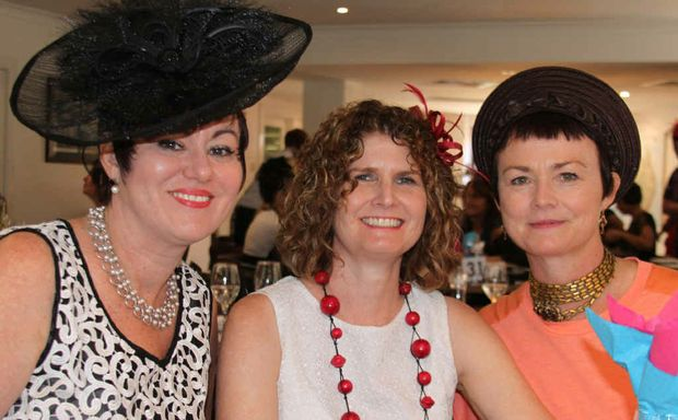 CUP DAY OUT: Marie Martin, Ali Adams and Pattsy Thomasson get stuck into celebrations at the Marist College's special luncheon at the Western Gateway Hotel yesterday.