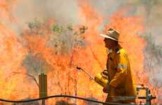 Rural firefighters fight off a grass fire near Mount Morgan.