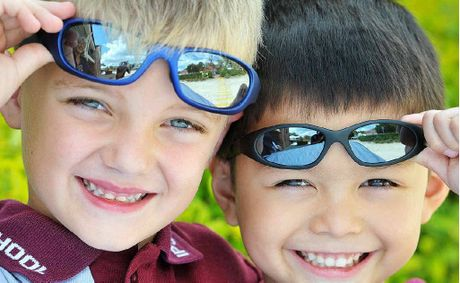 SUN SAFE: Ipswich Grammar School prep students Declan Hoffensetz and Henric Stoessel get in the spirit of National Sunnies Day.