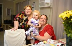 Leigh-Anne and Susan Noonan with their daughter Ruby, now two, at their Gladstone home.
