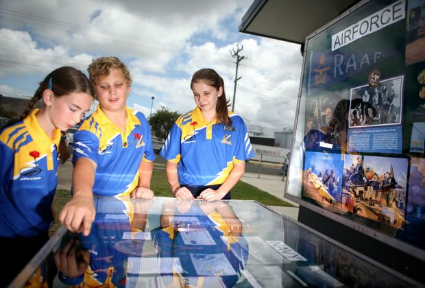 Isobel Thwaite, Theo Fourie and Rebecca Johnson from Allenstown State School look at rememberance display Photo Allan Reinikka / The Morning Bulletin