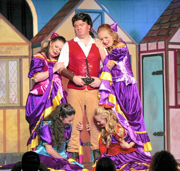 "Peter Hodges as Gaston with the ""Silly Girls"" Laura Smith, Steph Bateman, Jess Barnes and Leah Tidey."