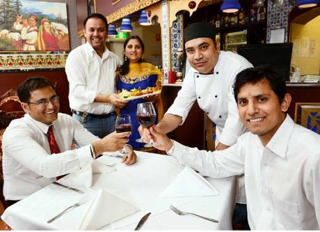 WAITING EAGERLY: Mehfil Indian Restaurant owners Rajesh and Priyanka Sharma (rear) and staff from left, Jasan Singh, Pitamber Duff and Sony Singh will host the Mehfil Diwali celebrations.