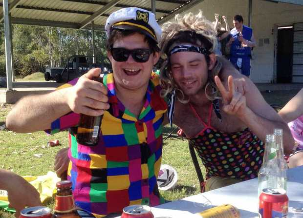 DROWNING THE SORROWS: Celebrating Silly Sunday with Emerald Rams captain Sam Thomasson following a grand final loss.