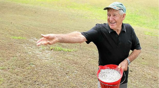 Former Woombye pineapple farmer and now hobby farmer Fred Hatchman warms up his fertiliser spreading arm in readiness for rain.