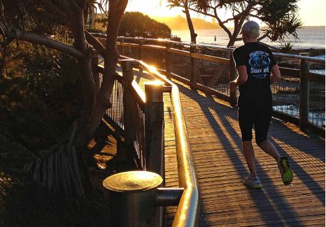 An early morning jogger at Happy Valley, Caloundra. Experts warn of preserving the Coast's character.